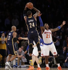 Paul George rises over Knicks Iman Shumpert in the game's final seconds a play in which Shumpert fouled George and he promptly went to the line and made all three free throws to send the game into overtime.