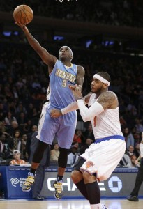 Ty Lawson who goes to the hoop on Carmelo is the only player remaining on the Denver roster from when he was on the team just 3 years ago.