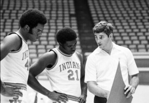 Quinn Buckner (21) with Indiana University head coach Bobby Knight were the last college basketball team to go through an entire seaosn undefeated and winning a championship.  The year was 1976.