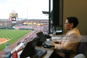 Claire Smith working in the press box.